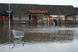 ©Licensed to London News Pictures 22/12/2019. <br /> Tonbridge ,UK.  Angel car park at the back of Sainsburys closed.  Mountain bikers enjoying the water. Heavy rain over night has caused more Christmas flooding in Kent.  Christmas shoppers in Tonbridge, Kent are facing severe disruption in the town centre with two car parks, roads and pathways all flooded and out of action as the River Medway bursts its banks. Photo credit: Grant Falvey/LNP