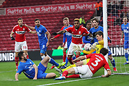Peterborough United goalkeeper Conor O'Malley (25) saves the ball from Middlesbrough defender George Friend (3)  during The FA Cup 3rd round match between Middlesbrough and Peterborough United at the Riverside Stadium, Middlesbrough, England on 5 January 2019.
