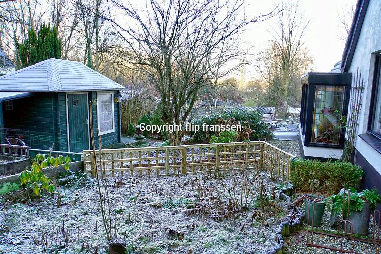 Nederland, Ubbergen, 21-1-2019Na een nacht met vorst is de bodem bedekyt met bevroren blad en ijskristallen . Foto: Flip Franssen
