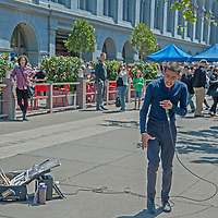 A street musician plays for Saturday crowds at the Embarcadero in downtown San Francisco, California.