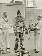 'Royal Navy diver on board HMS Camperdown prepa;ring to go down to examine the breach caused by a collision between HMS Camperdown and HMS Victoria, July 1893.'