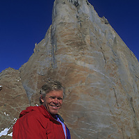 Rick Ridgeway stands in front of Rakekniven Spire, Queen Maud Land, Antarctica.