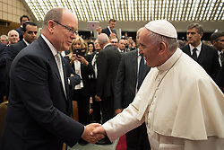 Pope Francis greets Prince Albert of Monaco, a participant ofSport at the Service of Humanity'sFirst Global Conference on Sport and Faith, which is being held in the Vatican.The event is being organized by the Pontifical Council for Culture. Photo by ABACAPRESS.COM