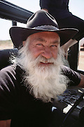 Mr. Fullerton of Fullerton's camels, Northern Territory, Australia. 100km south of Alice Springs. During the Pentax Solar Car Race. MODEL RELEASED.