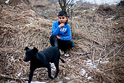"""Portrait of a young resident of the Roma part on the hill of the district """"Podsadek"""", located in a little valley. The city of Stara Lubovna is located about 100 km from Kosice in northeast Slovakia. The town has a population of 16350, of whom 2 060 (13%) are of Roma origin. The majority of Roma live in the Podsadek district, where 980 (74%) out of 1330 inhabitants are Roma."""