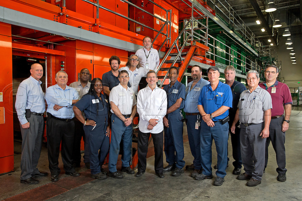 At center, David Landsberg, president and publisher of Miami Herald Media Co. with the move project team with the printing presses in Miami, FL,  on Wednesday, May 22, 2013...