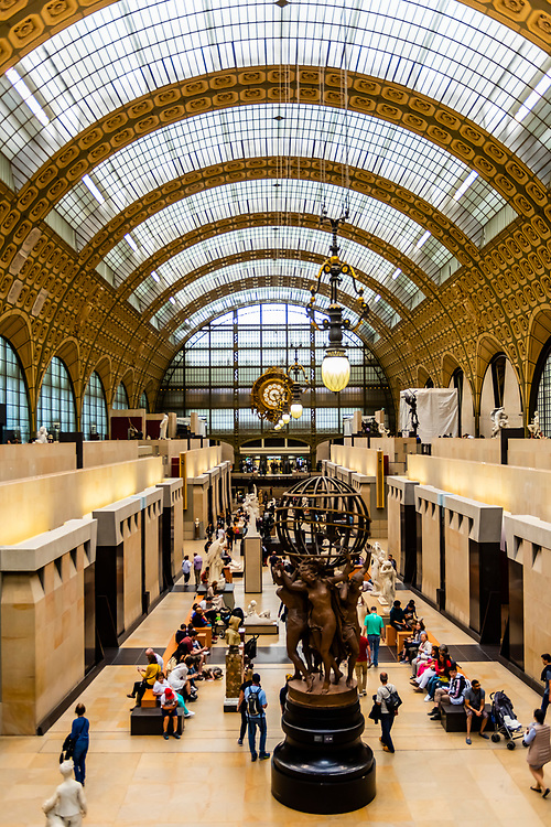 """Interior view of Musee d""""Orsay,  a museum in Paris, France, on the Left Bank of the Seine. It is housed in the former Gare d'Orsay, a Beaux-Arts railway station built between 1898 and 1900."""