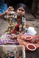 YANGON, MYANMAR - CIRCA DECEMBER 2013: Woman selling crab in the Yangon street market.
