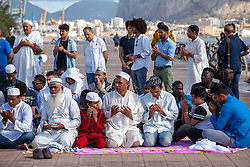 June 15, 2018 - Palermo, Italy - Muslims offer prayers during the Eid al-Fitr in Palermo. Eid al-Fitr is an important religious holiday celebrated by Muslims worldwide that marks the end of Ramadan, the Islamic holy month of fasting. (Credit Image: © Antonio Melita/Pacific Press via ZUMA Wire)