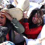 Participants in action during the International Pillow Fight Day in Washington Square Park, Manhattan New York. Events were also held in   Washington, D.C, Atlanta, Boston and Chicago. Elsewhere around the globe, pillow fights were planned in Hong Kong, London and Warsaw, Poland. Manhattan,  New York. 6th April 2012. Photo Tim Clayton