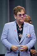 Zanger Elton John en de Britse prins Harry tijdens een sessie op het AIDS2018 congres over het werk van de Elton John Aids Foundation.<br /> <br /> Singer Elton John and the British Prince Harry during a session at the AIDS2018 congress about the work of the Elton John Aids Foundation.<br /> <br /> Op de foto:  Elton John