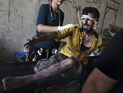 July 2, 2017 - Mosul, Iraq - Team from Global Response Management provide emergency medical care at a stabilization point near the Old City.  Civilians, many injured and weak, flee the continued battle with ISIS in West Mosul amid ruins of the city. (Credit Image: © Carol Guzy via ZUMA Wire)