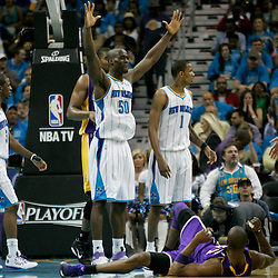 April 28, 2011; New Orleans, LA, USA; New Orleans Hornets center Emeka Okafor (50) reacts after being called for a foul on Los Angeles Lakers shooting guard Kobe Bryant (24) during the third quarter in game six of the first round of the 2011 NBA playoffs at the New Orleans Arena.    Mandatory Credit: Derick E. Hingle