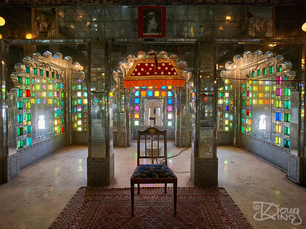 Room interior decorated with stained glass and mirrors at the City Palace in Udaipur, Rajasthan, India <br /> <br /> Editorial & Non-Commercial use only