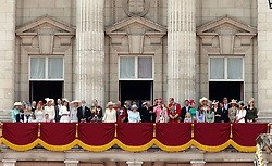 Queen Elizabeth II (centre in light blue) is joined by members of the Royal family on the balcony of Buckingham Palace, in central London, following the Trooping the Colour ceremony at Horse Guards Parade as the Queen celebrates her official birthday today.
