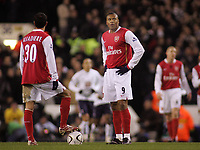 Photo: Paul Thomas.<br /> Tottenham Hotspur v Arsenal. Calring Cup, Semi Final 1st Leg. 24/01/2007.<br /> <br /> Dejected Julio Baptista (R) of Arsenal waits at the half way line after Spurs score.