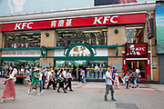 KFC, Kentucky Fried Chicken fast food chain store in the shopping district of Wangfujing in Beijing, China. Wangfujing, located in Dongcheng District, Beijing, and is one of the Chinese capital's most famous shopping streets. The majority of the main shopping area is pedestrianised and is very popular for shopping for both tourists and residents of the capital.