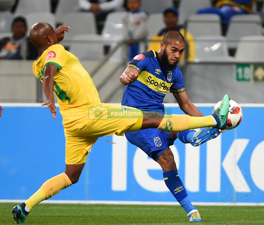 Cape Town-180818 Cape Town City defender Ebrahim Seedat challenged byDanny Venter of Golden Arrows in a PSL match at Cape Town Stadium .photograph:Phando Jikelo/African News Agency/ANA