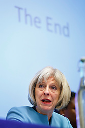 © Licensed to London News Pictures. 23/10/2014. London, UK. Home Secretary Theresa May answering questions during Policing and Mental Health National Summit at Central Hall Westminster in London on Thursday, 23 October 2014. In her speech, Home Secretary revealed new measures to change the way police forces deal with mental health patients. Photo credit : Tolga Akmen/LNP