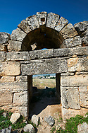 Picture of the ruins of a gate to Hieropolis. Hierapolis archaeological site near Pamukkale in Turkey. .<br /> <br /> If you prefer to buy from our ALAMY PHOTO LIBRARY  Collection visit : https://www.alamy.com/portfolio/paul-williams-funkystock/pamukkale-hierapolis-turkey.html<br /> <br /> Visit our TURKEY PHOTO COLLECTIONS for more photos to download or buy as wall art prints https://funkystock.photoshelter.com/gallery-collection/3f-Pictures-of-Turkey-Turkey-Photos-Images-Fotos/C0000U.hJWkZxAbg