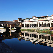 FLORENCE, ITALY - NOVEMBER 01: The Ponte Vecchio (Old Bridge) is a medieval bridge spanning the river Arno in Florence. It is one of the few remaining bridges with houses built upon. The Vasari corridor that runs over the houses connects the Uffizi with the Pitti Palace on the other side of the river. Florence, Italy, 1st November 2017. Photo by Tim Clayton/Corbis via Getty Images)