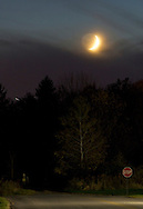 Middletown, New York - The crescent moon shines above a bank of clouds on  Oct. 17, 2012.