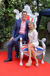 JAMES RAMSDEN and EMMA SPENCER at the launch of Chelsea Thoroughbreds held at St.Luke's Church, Sydney Street, London on 2nd July 2014.