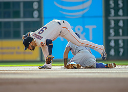 July 28, 2018 - Houston, TX, U.S. - HOUSTON, TX - JULY 28:  Houston Astros second baseman Marwin Gonzalez (9) tags Texas Rangers second baseman Rougned Odor (12) trying to steal second base in the top of the first inning during the baseball game between the Texas Rangers and Houston Astros on July 28, 2018 at Minute Maid Park in Houston, Texas.  (Photo by Leslie Plaza Johnson/Icon Sportswire) (Credit Image: © Leslie Plaza Johnson/Icon SMI via ZUMA Press)