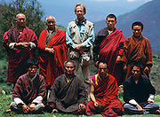 Photographer Peter Menzel poses with Buddhist Monks in Shingkhey, Bhutan, while on assignment shooting for the Material World Project. Published in Material World: A Global Family Portrait, back cover, inside flap.