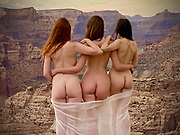 Three nude women, facing away from the camera, gauze around their legs, and standing at the top of a cliff in the <br /> Little Grand Canyon, Utah