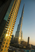 The famous Burj Khalifa, the tallest building in the world, as of 2021 in Dubai, United Arab Emirates at sunrise as seen from the Ramada Downtown Dubai
