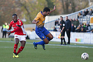 Malvind Benning of Mansfield Town (3) is fouled by Mark Marshall of Charlton Athletic (7) during the The FA Cup match between Mansfield Town and Charlton Athletic at the One Call Stadium, Mansfield, England on 11 November 2018.