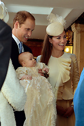 File photo dated 23/10/13 of The Duke and Duchess of Cambridge with their son Prince George, ahead of Prince George's christening. The Duke and Duchess of Sussex's baby son Archie is expected to be baptised in the same royal christening gown.