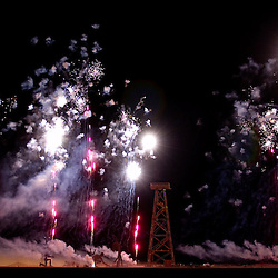 """Fireworks explode prior to the burning of """"Crude Awakening,"""" Saturday night, Sept. 1, 2007 during the annual Burning Man Festival on the Black Rock Desert near Gerlach, Nev. This year's theme was The Green Man. """"Crude Awakening"""" was the largest structure on the play. It resembled a large wooden oil derrick...Photo by David Calvert/Nevada Sagebrush"""
