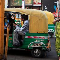 Asia, India, Calcutta.  A woman and taxi on streets of Calcutta.