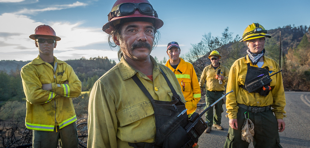 Crew Chief Jonathon Alvarez works with his Roseburg, Oregon Diamond Fire Crew members as they remove brush on Franz Valley School Road after the Tubbs Fire in Sonoma County.