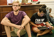 Giovanni Rocco, 21, listens during a Dream Defenders meeting while Isis Alvarez, 19, monitors the group's social media efforts July 23, 2013, in Florida Gov. Rick Scott's office at the state capitol in Tallahasee. (Photo by Carmen K. Sisson/Cloudybright)