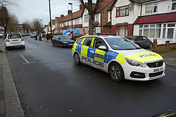 © Licensed to London News Pictures. 19/12/2018. London UK: Police cordon off St Joseph's road in Enfield, north London after a male was found with fatal gun shot wounds at around 10 pm last night. Three men have been arested and are helping police with the murder investigation , Photo credit: Steve Poston/LNP