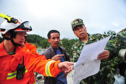 August 28, 2017  Rescuers work at the site of landslide in Zhangjiawan Town of Nayong County, southwest China's Guizhou Province. The death toll has risen to three, with 32 others are missing after the landslide occurred Monday morning.  (Credit Image: © Tao Liang/Xinhua via ZUMA Wire)