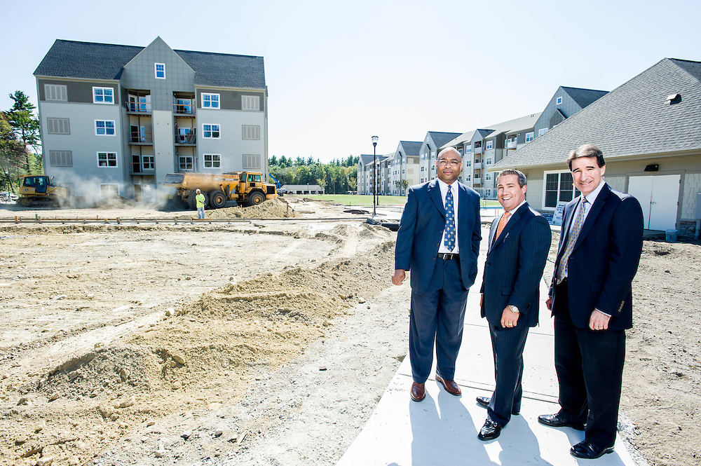 The Mass Housing's Director of Rental Lending Monte Stanford, Princeton Properties President Andrew Chaban, and Managing Director of Mass Housing Partnership Mark Curtiss tour the grounds of the Princeton Westford development.  Photographed for the Mass Housing Annual Report.