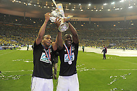 FOOTBALL - FRENCH CUP 2011/2012 - FINAL - OLYMPIQUE LYONNAIS v US QUEVILLY - 28/04/2012 - PHOTO JEAN MARIE HERVIO / REGAMEDIA / DPPI - CELEBRATION JIMMY BRIAND AND ALY CISSOKHO (OL) WITH THE TROPHY AFTER THE VICTORY