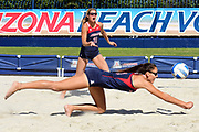 Arizona blocker Halli Amaro (3) dives for a dig as defender Brooke Burling (31) looks on during Arizona's 4-1 win against New Mexico at Jimenez Field in Tucson, Arizona on Friday, March 31, 2017. (Rebecca Noble/The Daily Wildcat)