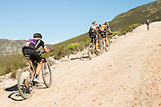 Ariane Kleinhans (front) and Annika Langvad of Team RECM2 pass Andrew Mclean of team Cycle Lab Toyota during stage 5 of the 2014 Absa Cape Epic Mountain Bike stage race held from The Oak Estate in Greyton to Oak Valley Wine Estate in Elgin, South Africa on the 28 March 2014<br /> <br /> Photo by Greg Beadle/Cape Epic/SPORTZPICS