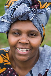 Woman wearing traditional African dress; smiling,