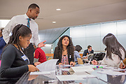 Purchase, NY – 31 October 2014. Morgan Stanley facilitator Ahkiel White with Paola Ferreira, center, and some of the team from Lincoln High School. The Business Skills Olympics was founded by the African American Men of Westchester, is sponsored and facilitated by Morgan Stanley, and is open to high school teams in Westchester County.