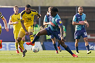 Anthony Stewart of Wycombe Wanderers und repressor fro Jerome Sinclair of Oxford United during the EFL Sky Bet League 1 match between Oxford United and Wycombe Wanderers at the Kassam Stadium, Oxford, England on 30 March 2019.