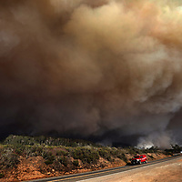 A massive column of smoke rises above Waddell Creek as the CZU August Lightning Complex burns along Highway 1 on August 19, 2020 at the Santa Cruz/San Mateo county line. The blaze, one of more than 600 in the state, ha burned more that 800,000 acres, destroyed more than 900 homes, forced more than 77,000 evacuations and was only 46% contained by September 2.