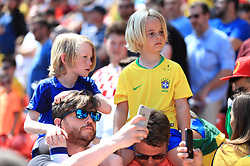 Young fans in the stands show their support