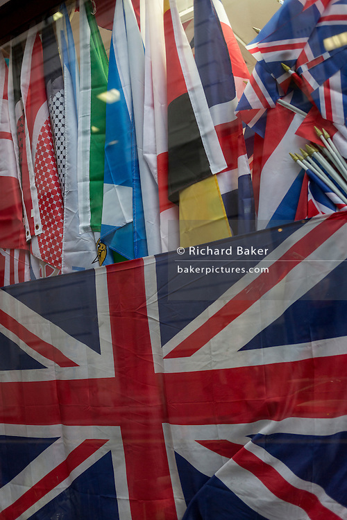 The flags of other nations above the crumpled British Union Jack flag in the window of a City retailer, on 2nd February 2017, in the City of London, England.