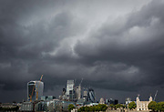 Storm clouds gather and dark times are ahead for the modern City of London with the Norman-era Tower of London, right, on 14th September 2017, in London, England. The City is the historical financial district founded by the Romans in the 1st Century but faces a post-Brexit financial uncertainty.